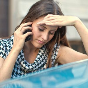 Woman feeling stressed out while making a call
